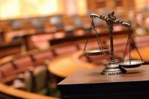 Der Ablauf einer Privatinsolvenz umfasst auch einen gerichtlichen Einigungsversuch.
